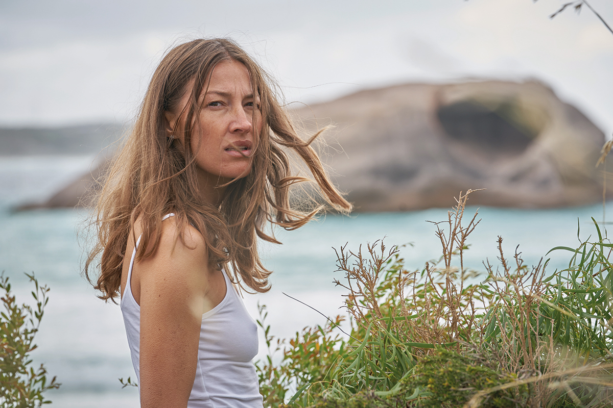 Georgie Jutland (Kelly Macdonald) at the beach in White Point. Location: Twilight Beach, West Beach. Credit: Kerry Brown