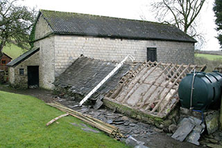 External view of the barn before restoration
