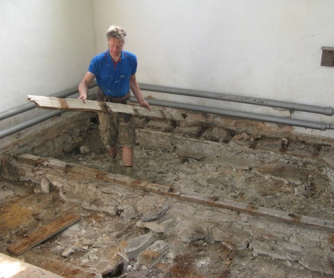 Removing the old dry-rot damaged floor joists in the church