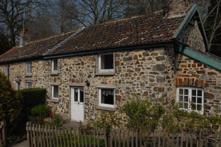 External view of the cottage before the renovation