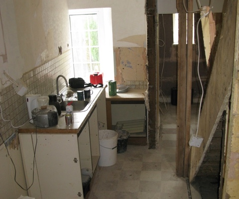he kitchen before the cottage renovation