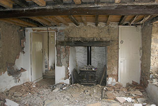 The fire-place in the sitting room during renovation