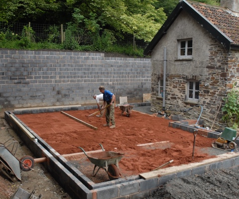 Construction work on the foundation of the extension