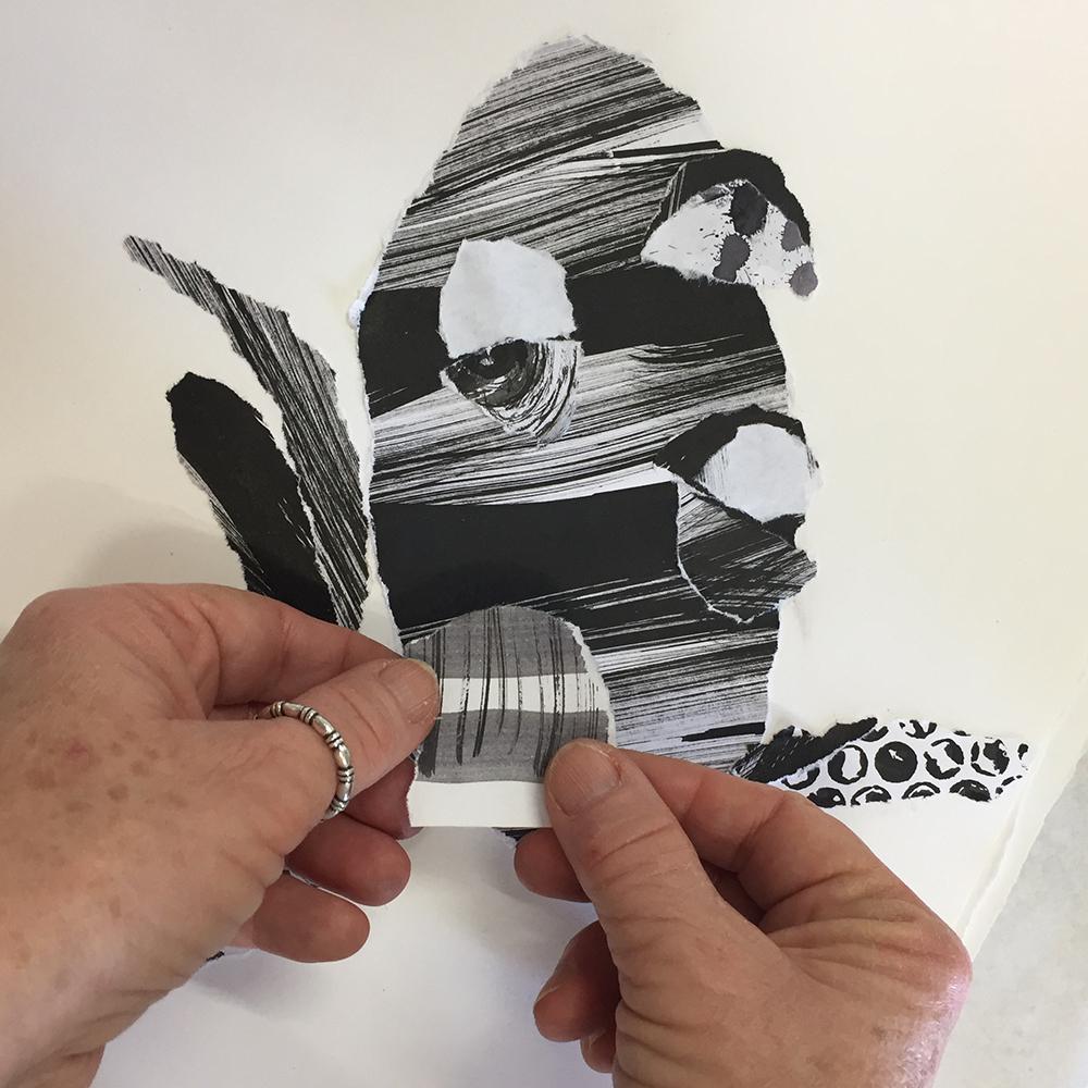 hands placing paper