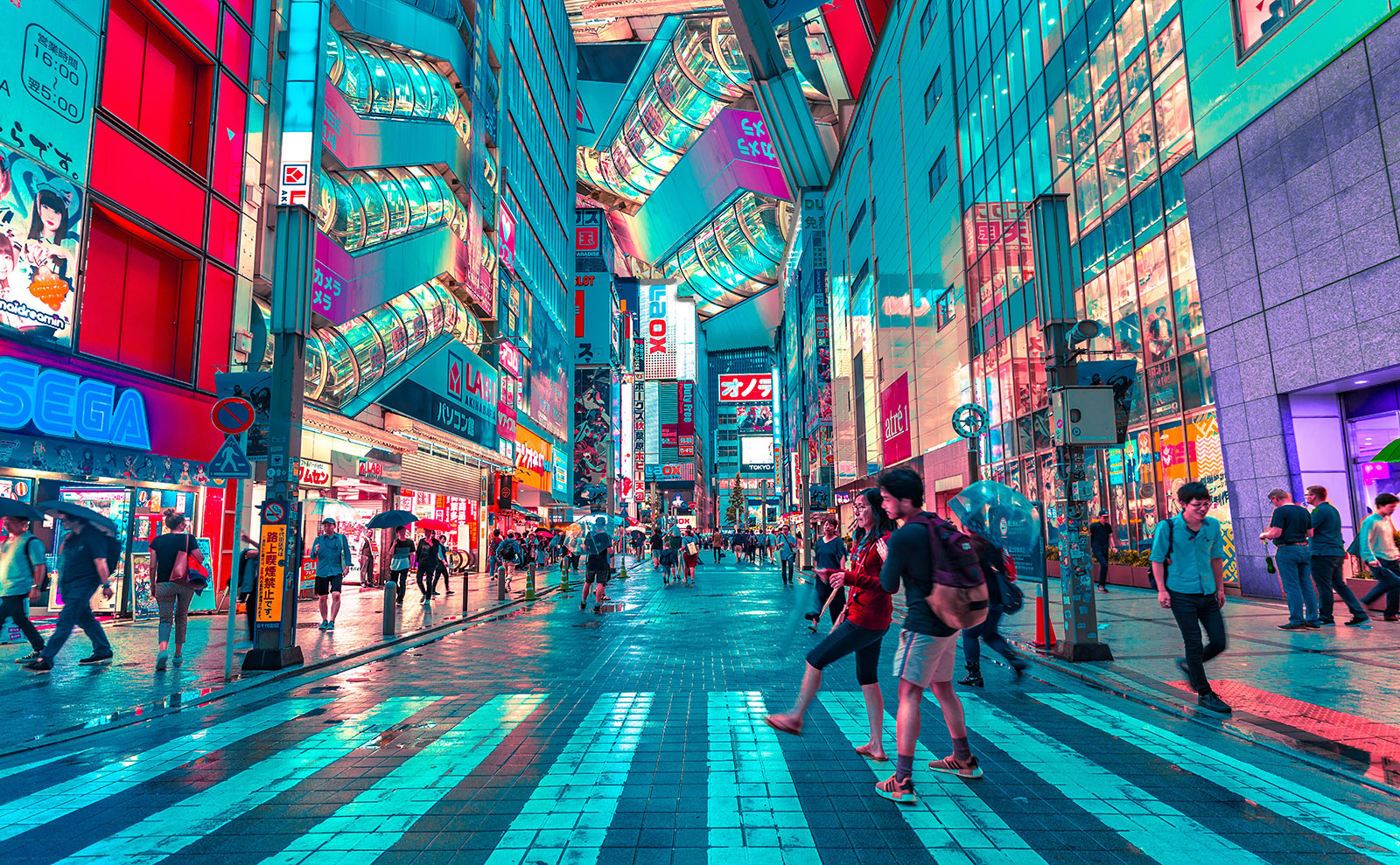 street in tokyo crowded with people and lit by neon