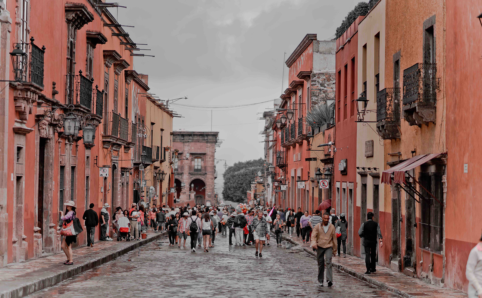 pink buildings on a street in San Miguel de Allende, Mexico