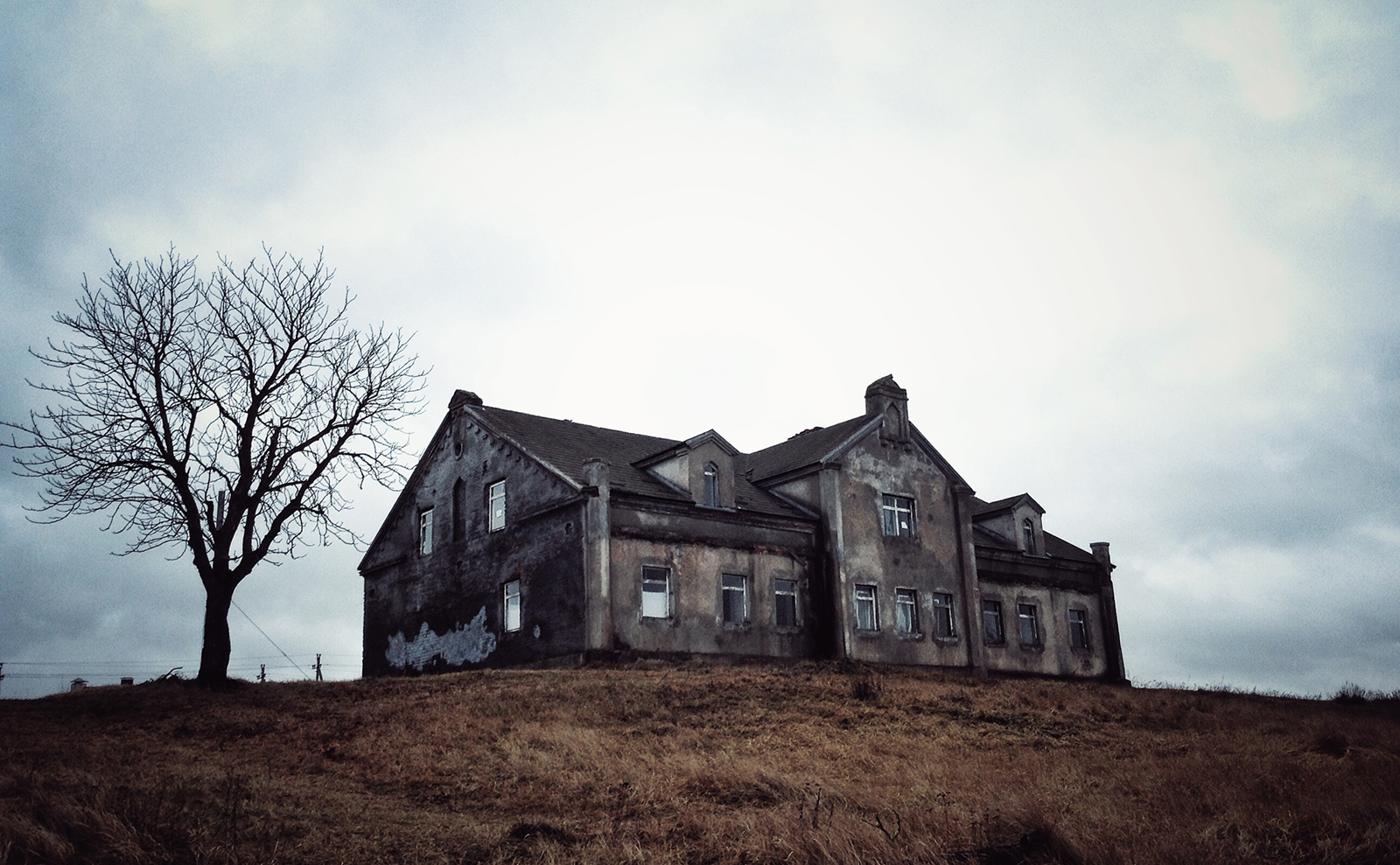 haunted house on a hilltop