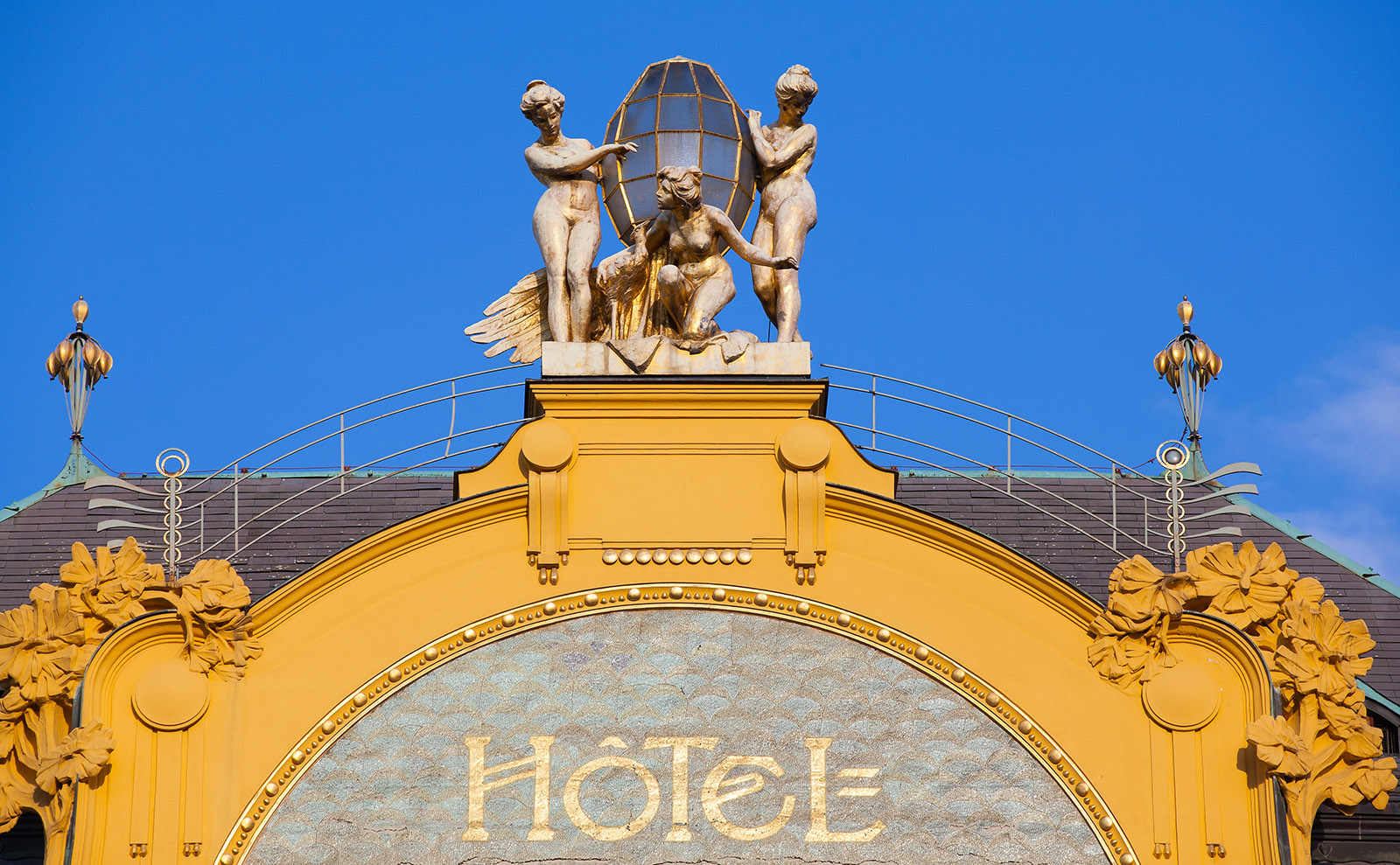 the facade of the hotel europa in prague against a blue sky