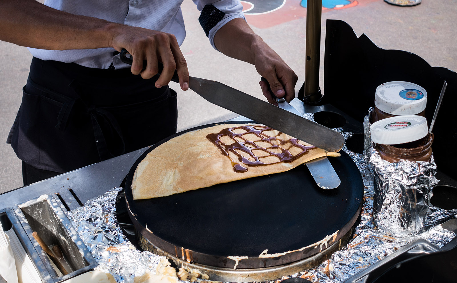 crepe being made on a street cart