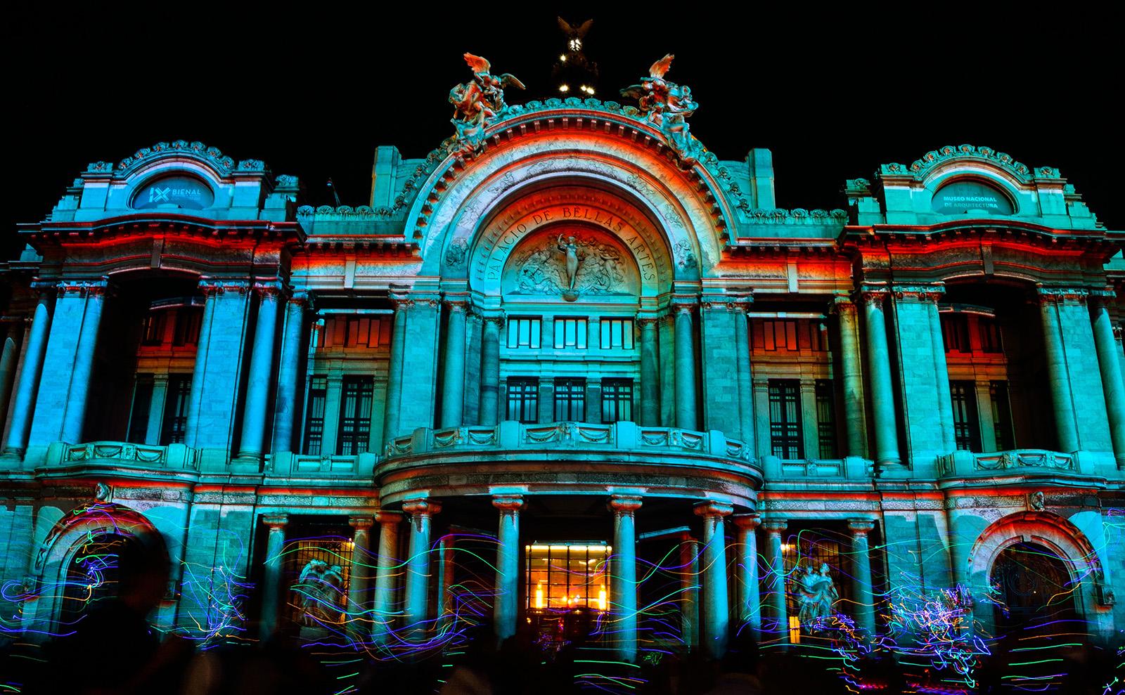 neon-colored video mapping on the Palacio de Bellas Artes in Ciudad de México, Mexico