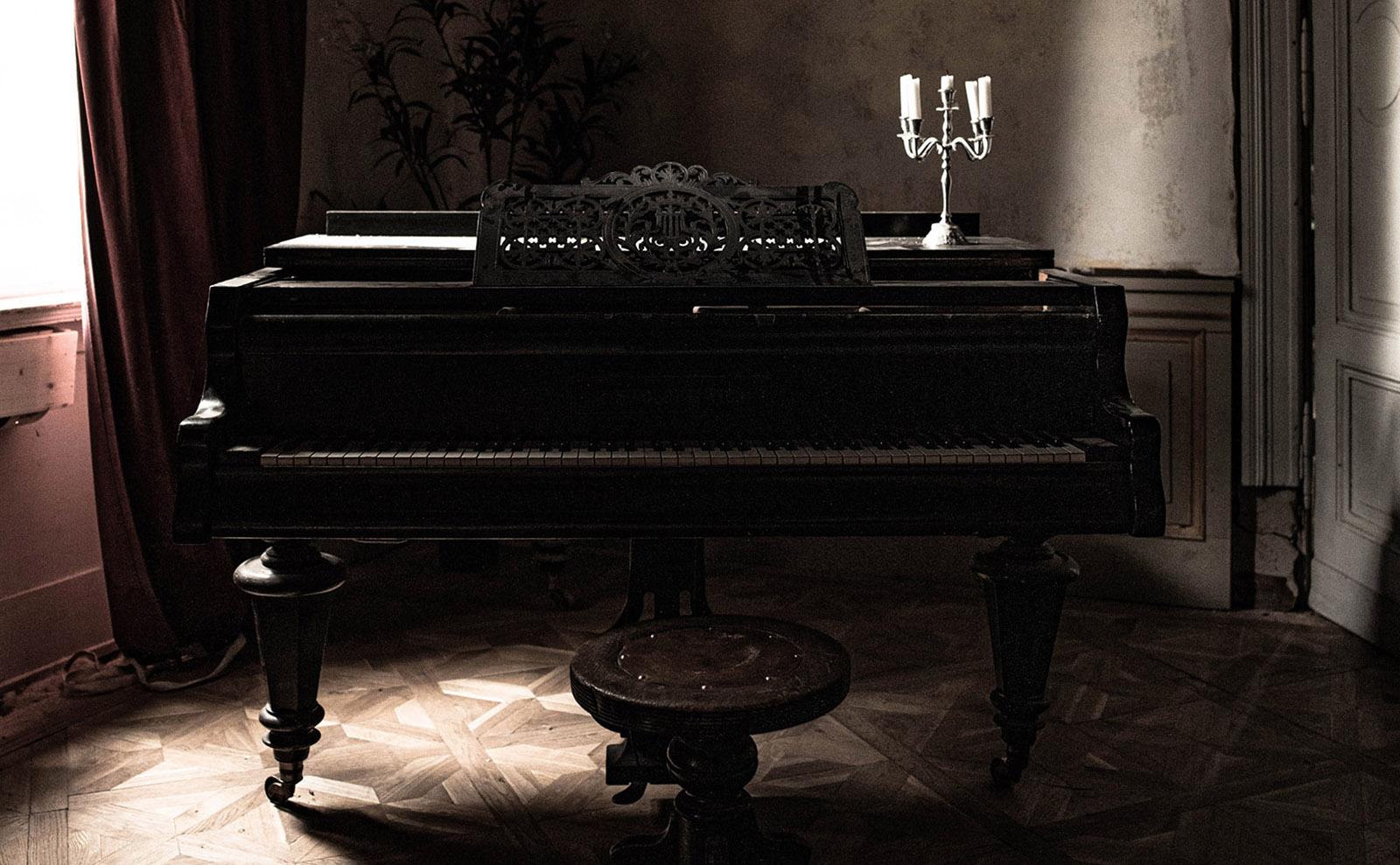 creepy piano with a candelabra