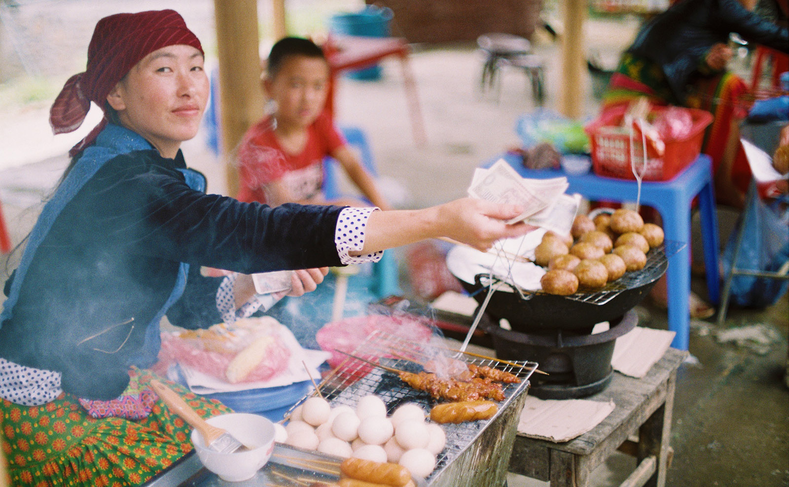 woman selling rice balls by the roadside
