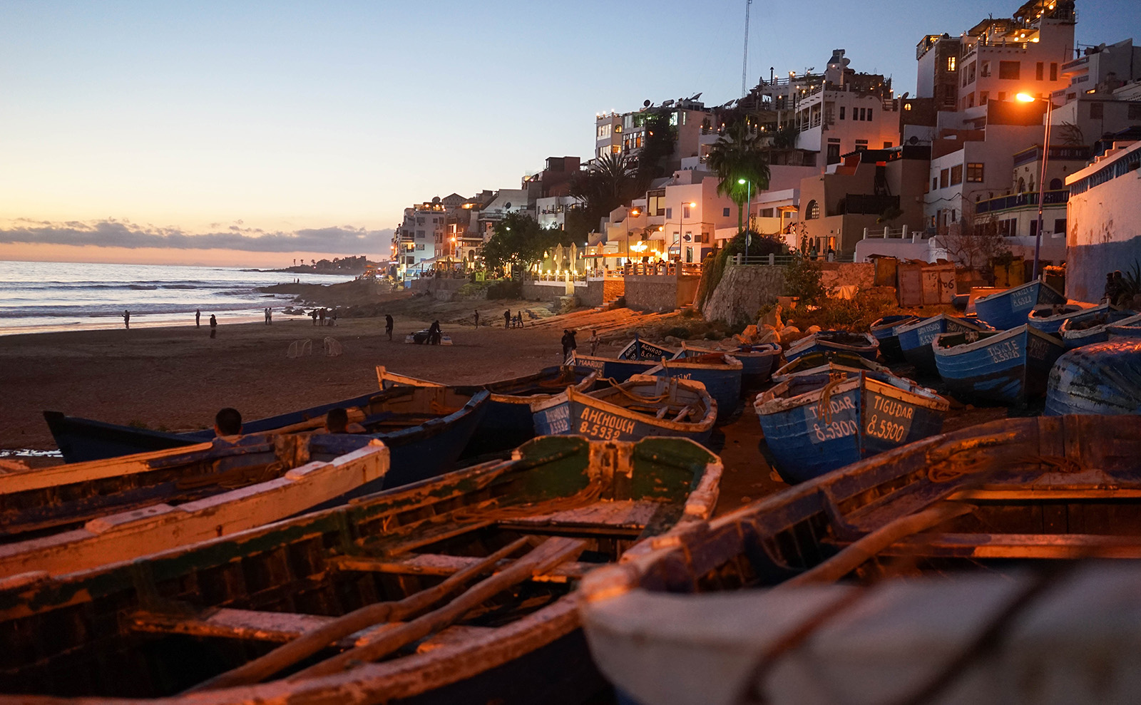 boats on a beach in morocco
