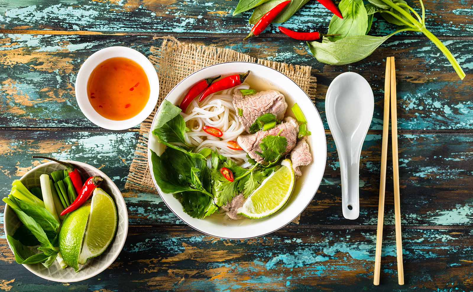 bowl of pho on wooden table