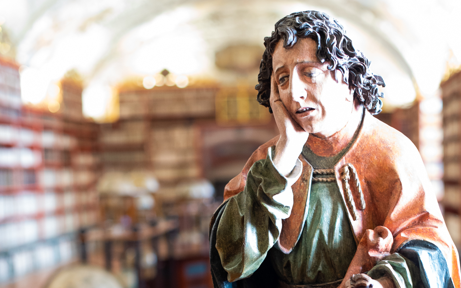statue of a sad monk in the theological hall