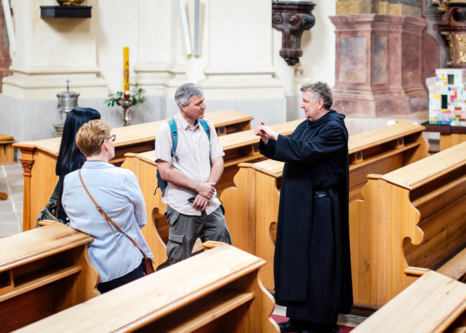 monk explaining the history of the monastery