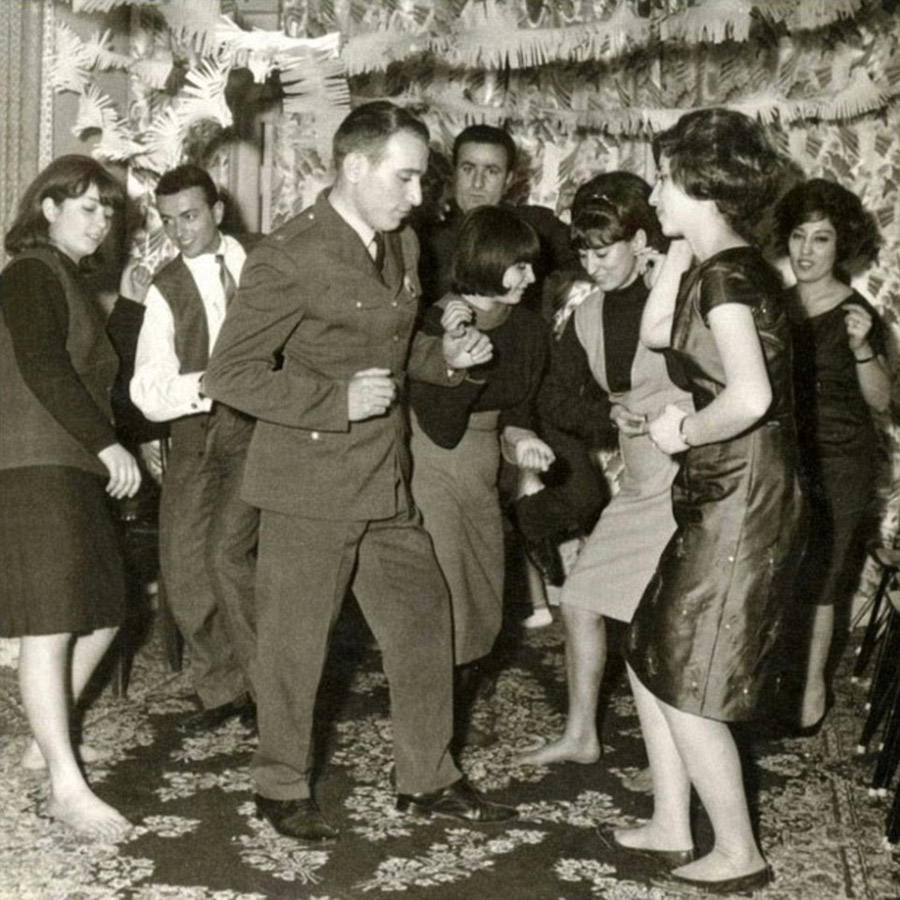 black and white photo of young people dancing in iran