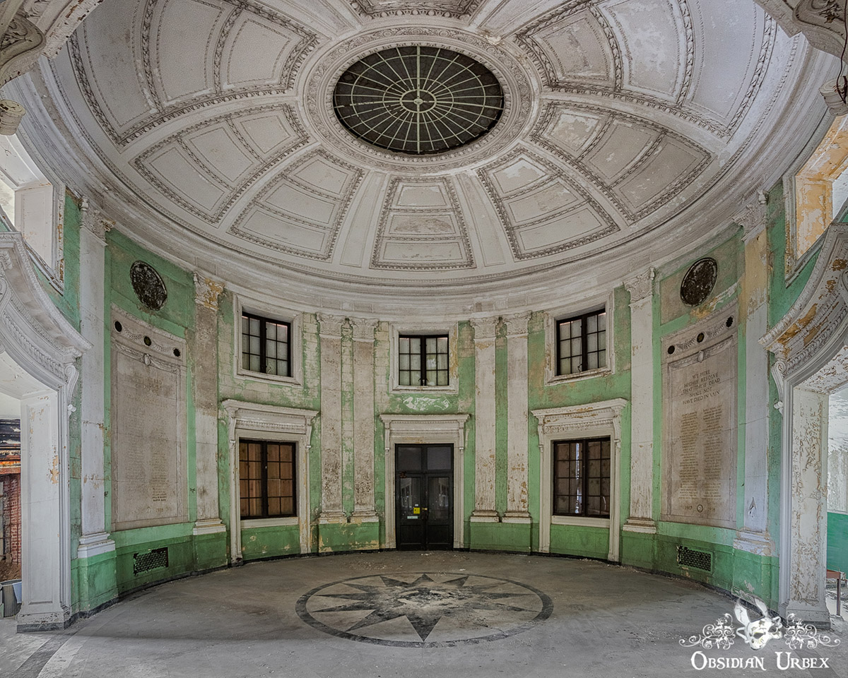 abandoned town hall with mint green rotunda