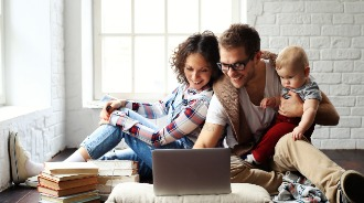 Mother, father and child using their laptop