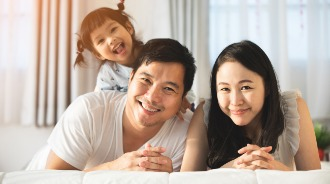 Mother, father and child smiling