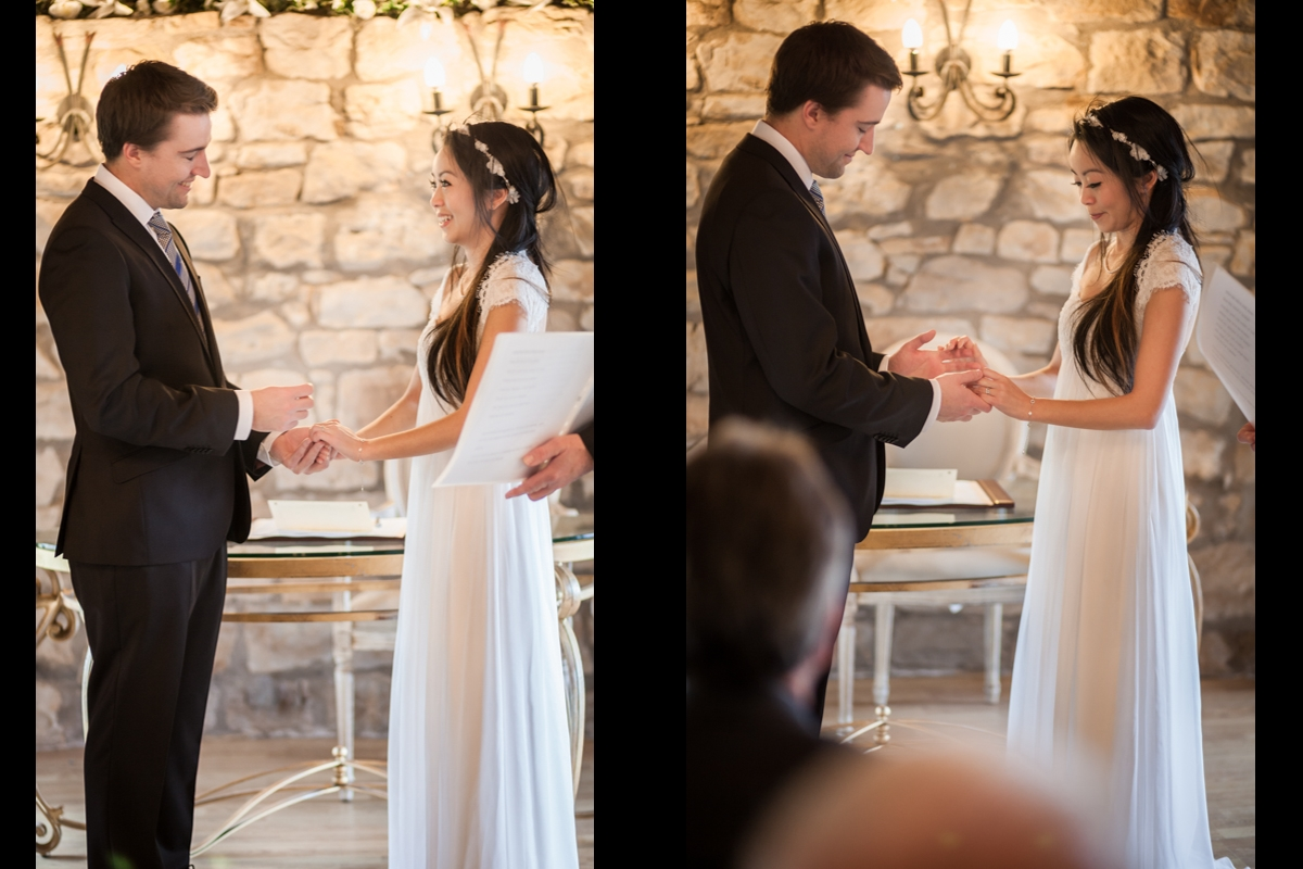 Bride and groom exchanging rings at the wedding ceremony at Harburn House