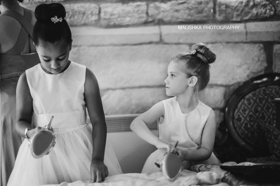 Little bridesmaids helping the bride at Dalhousie Castle in Edinburgh