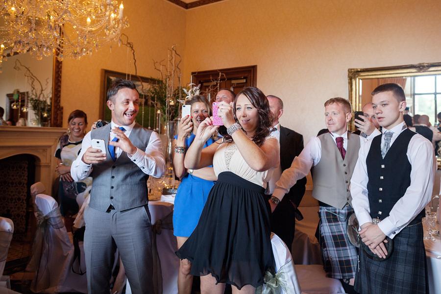Scotland wedding photographer capturing wedding guests at Dalhousie Castle