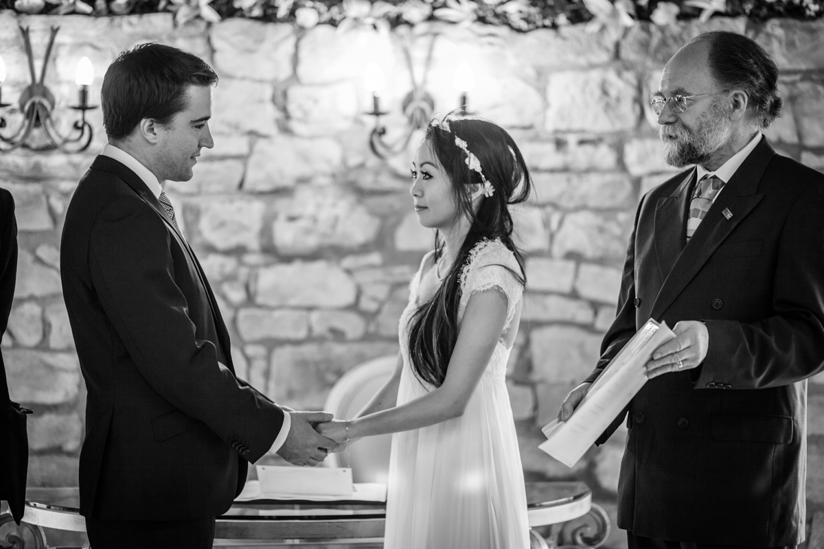 Bride and groom exchanging vows at Harburn House wedding ceremony