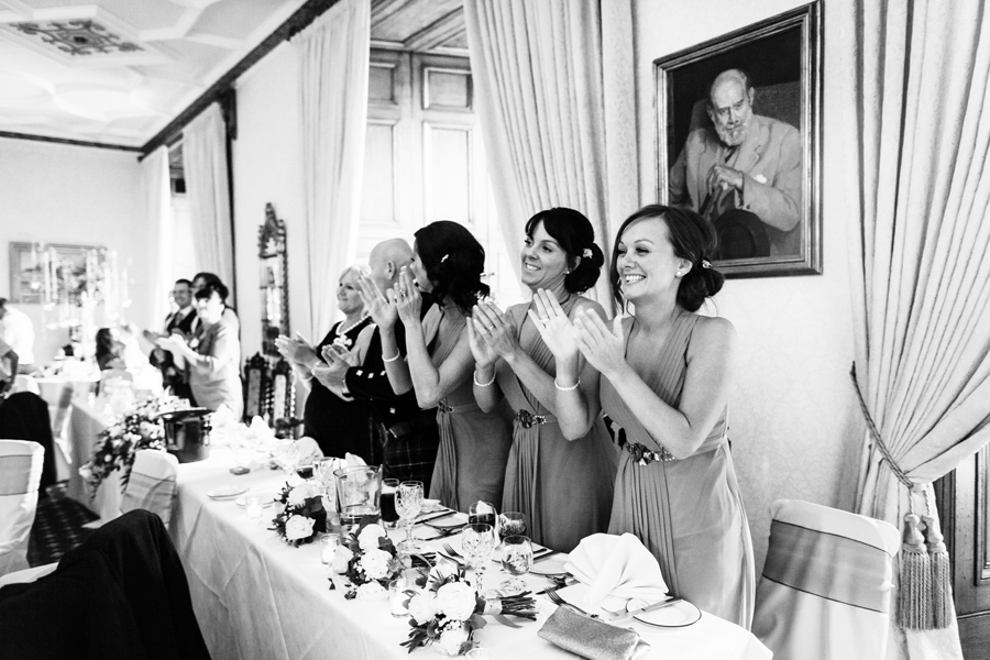 Bridesmaids cheering for the couple entrance at Dalhousie Castle wedding