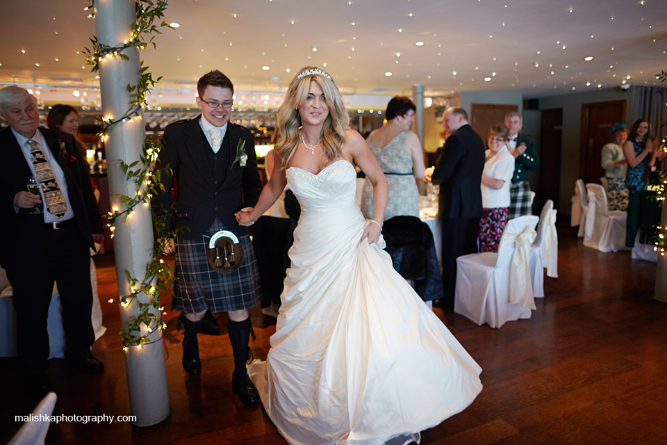 Bride and groom entering the room
