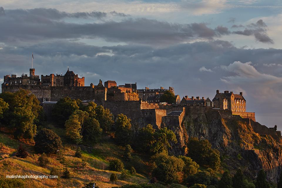 Edinburgh Castle illuminated by the light of setting sun