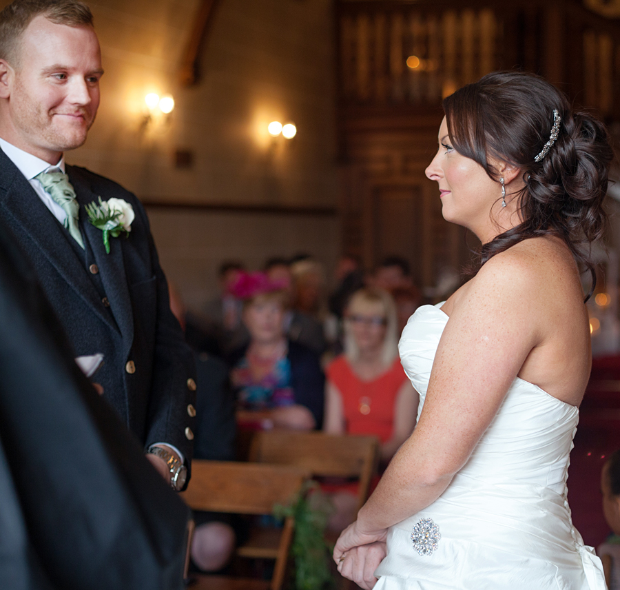 Bride and Groom during the wedding ceremony at Dalhousie Castle