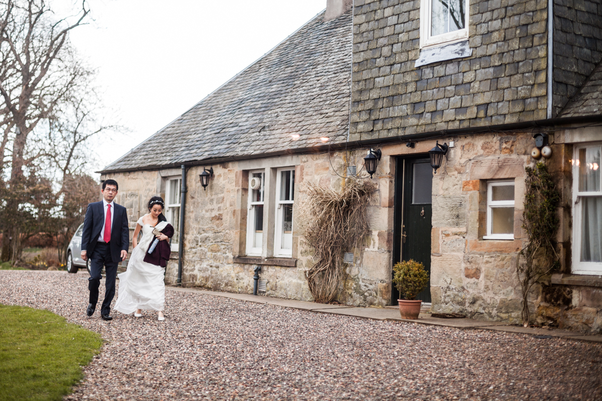 Bride and her father approaching Harburn House