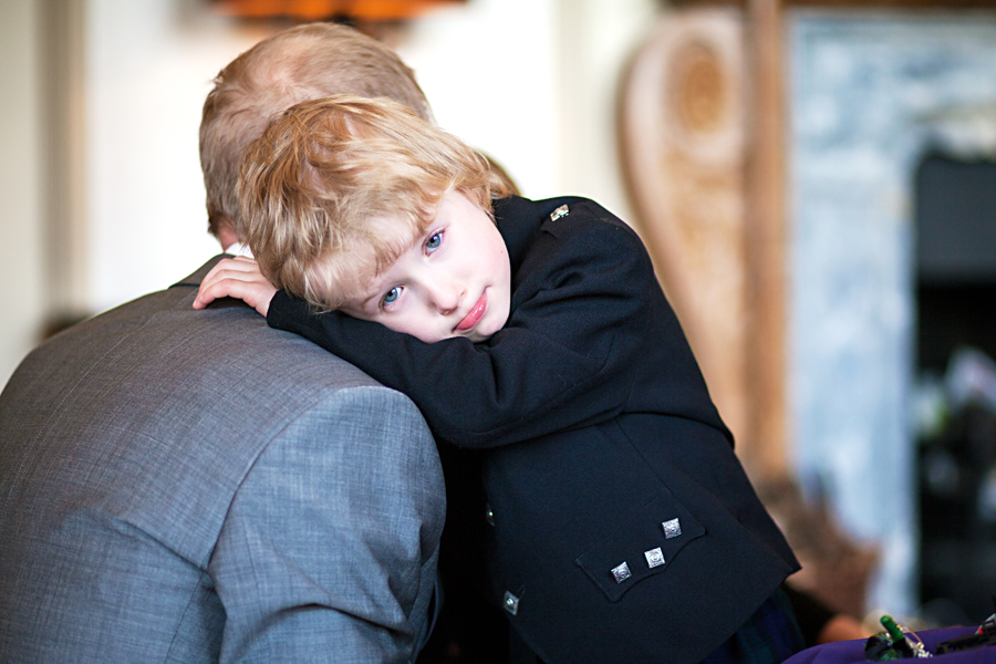 Groom getting a hug from his little son before the wedding ceremony at Cringletie House