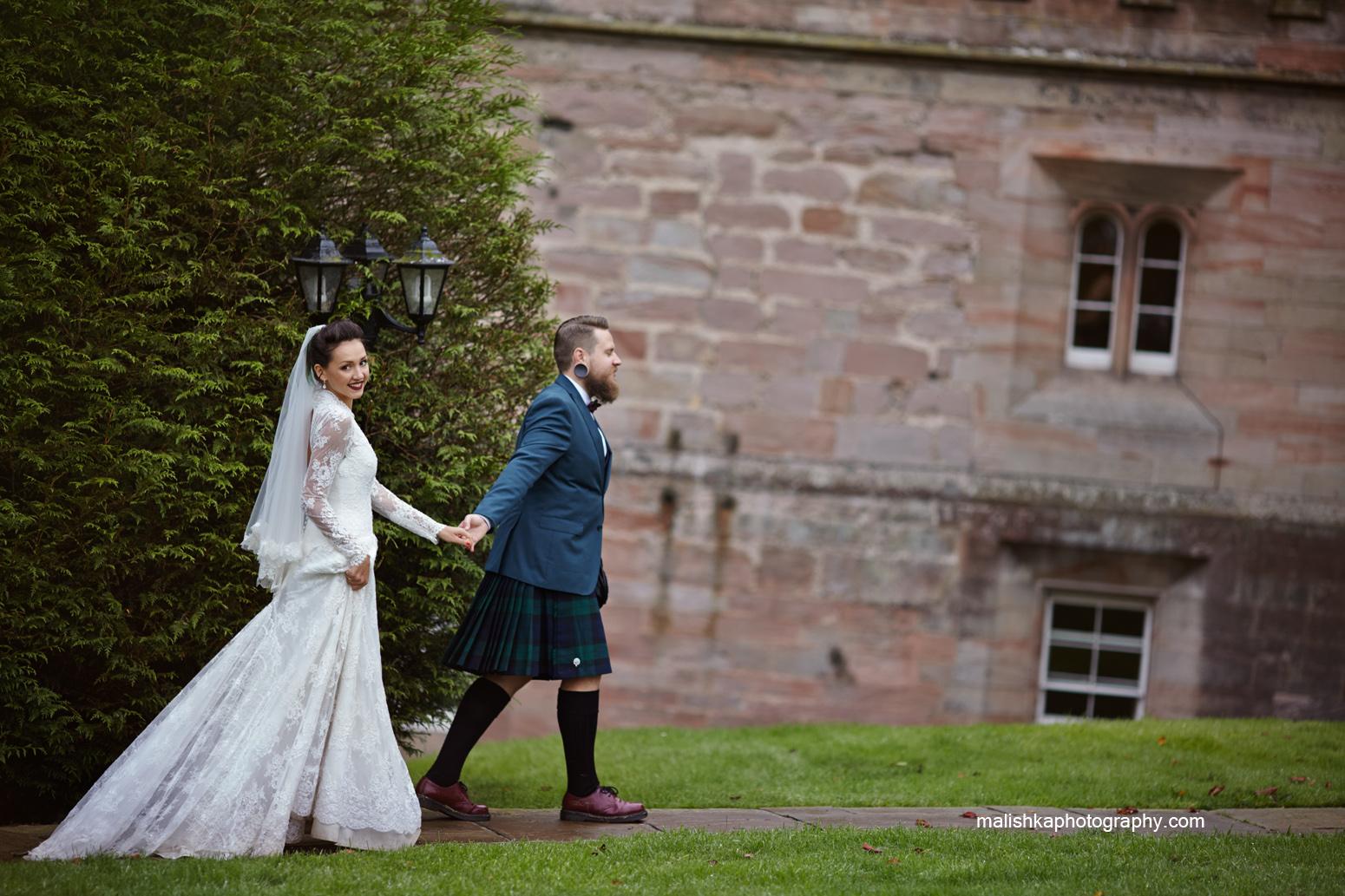 Happy couple at Dalhousie Castle wedding