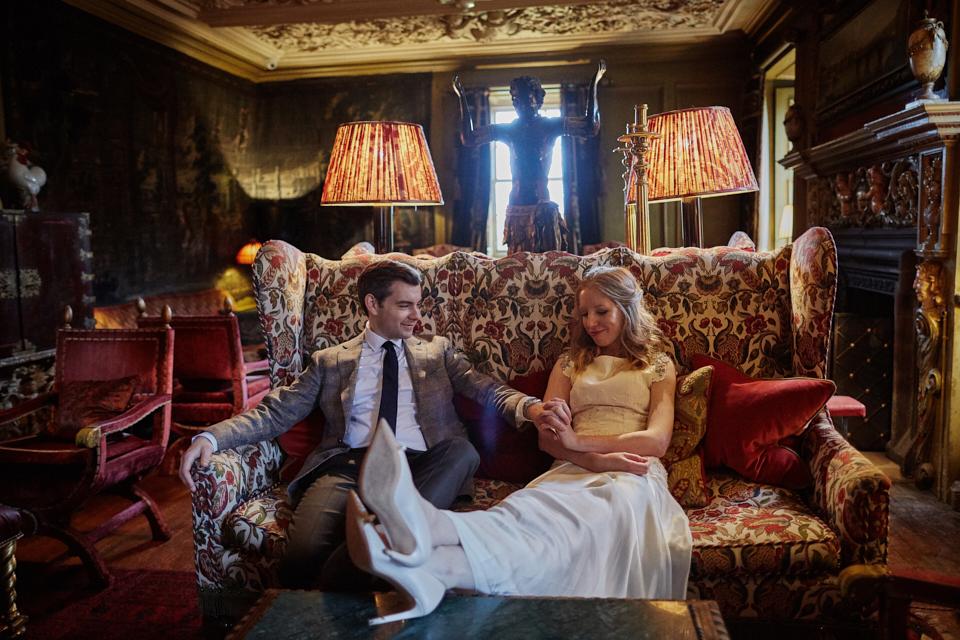 Happy couple on the sofa in Prestonfield House Hotel Edinburgh