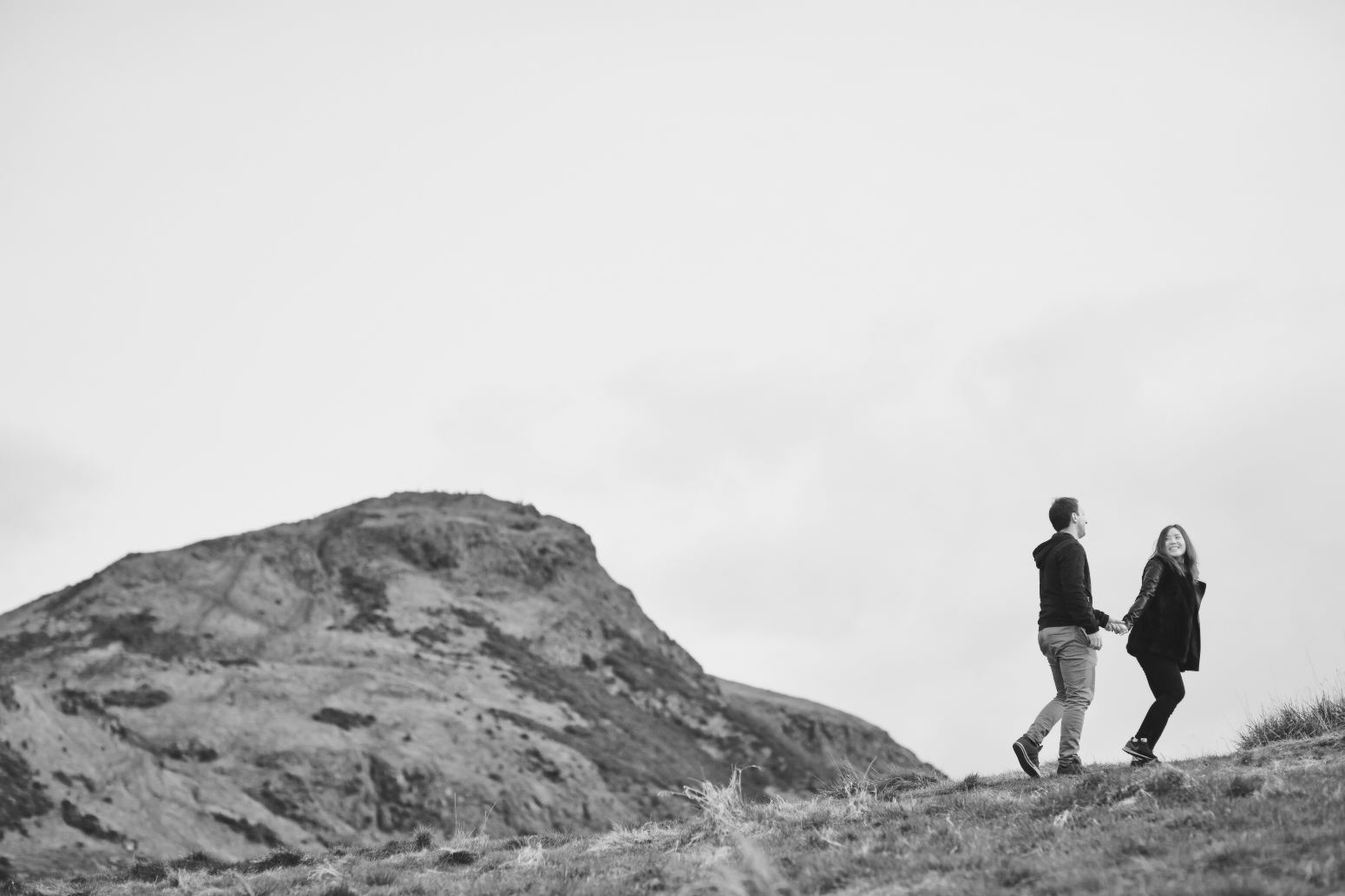 Happy couple captured by Edinburgh wedding photographer in the hills