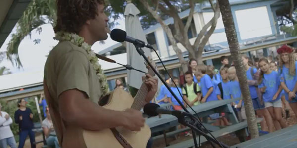 Jack Johnson plays music for kids at an elementary school in Hawaii as part of his Kokua Foundation work