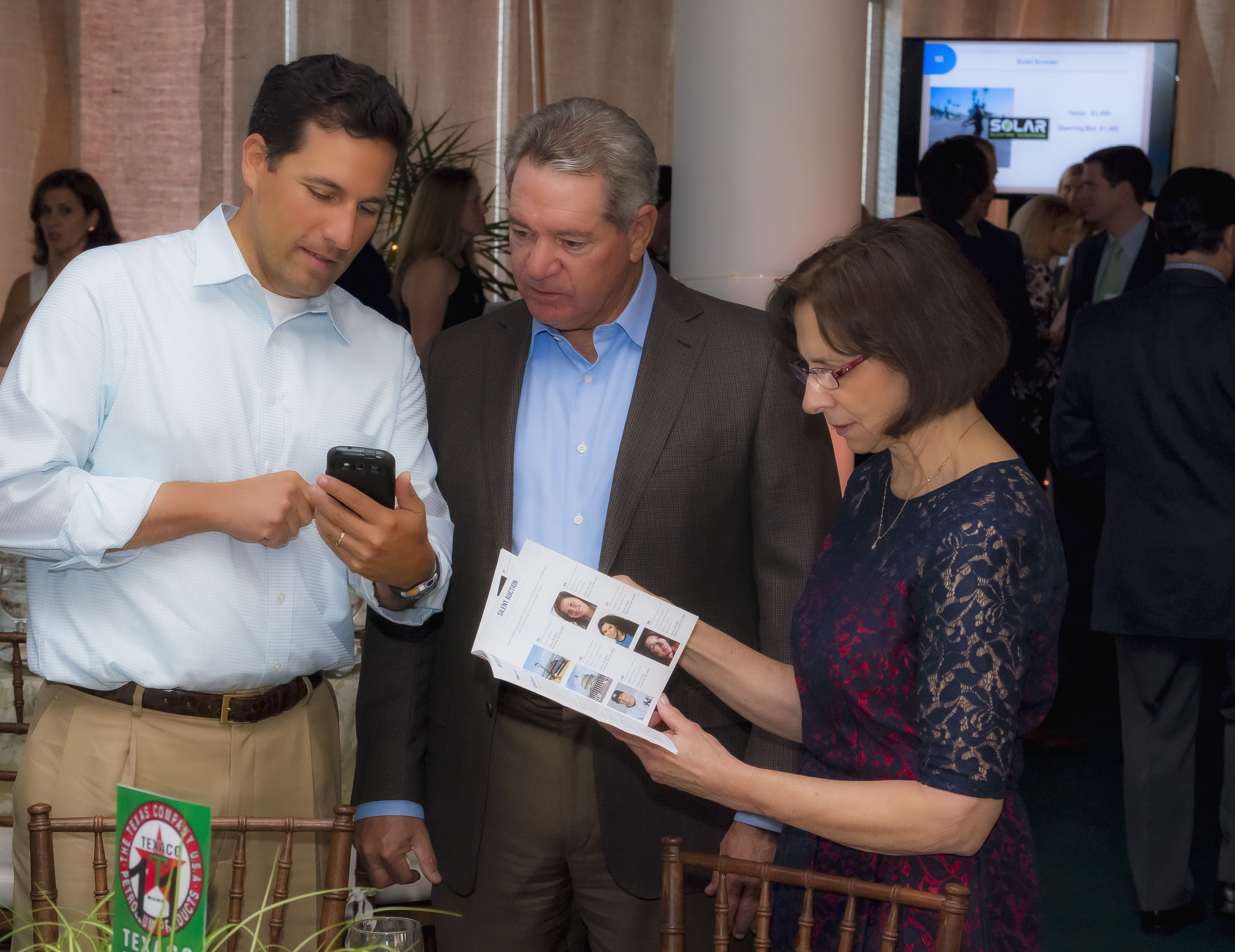Gala attendees bidding on their phones