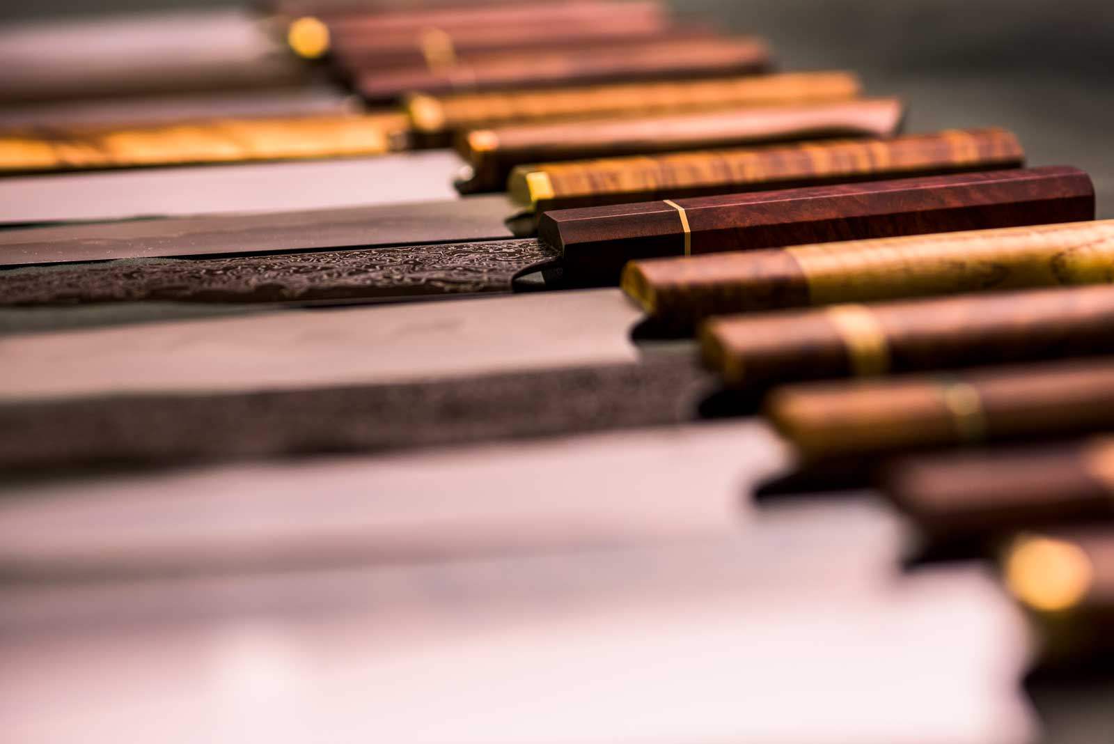 Row of knives with centre knife being point of focus.