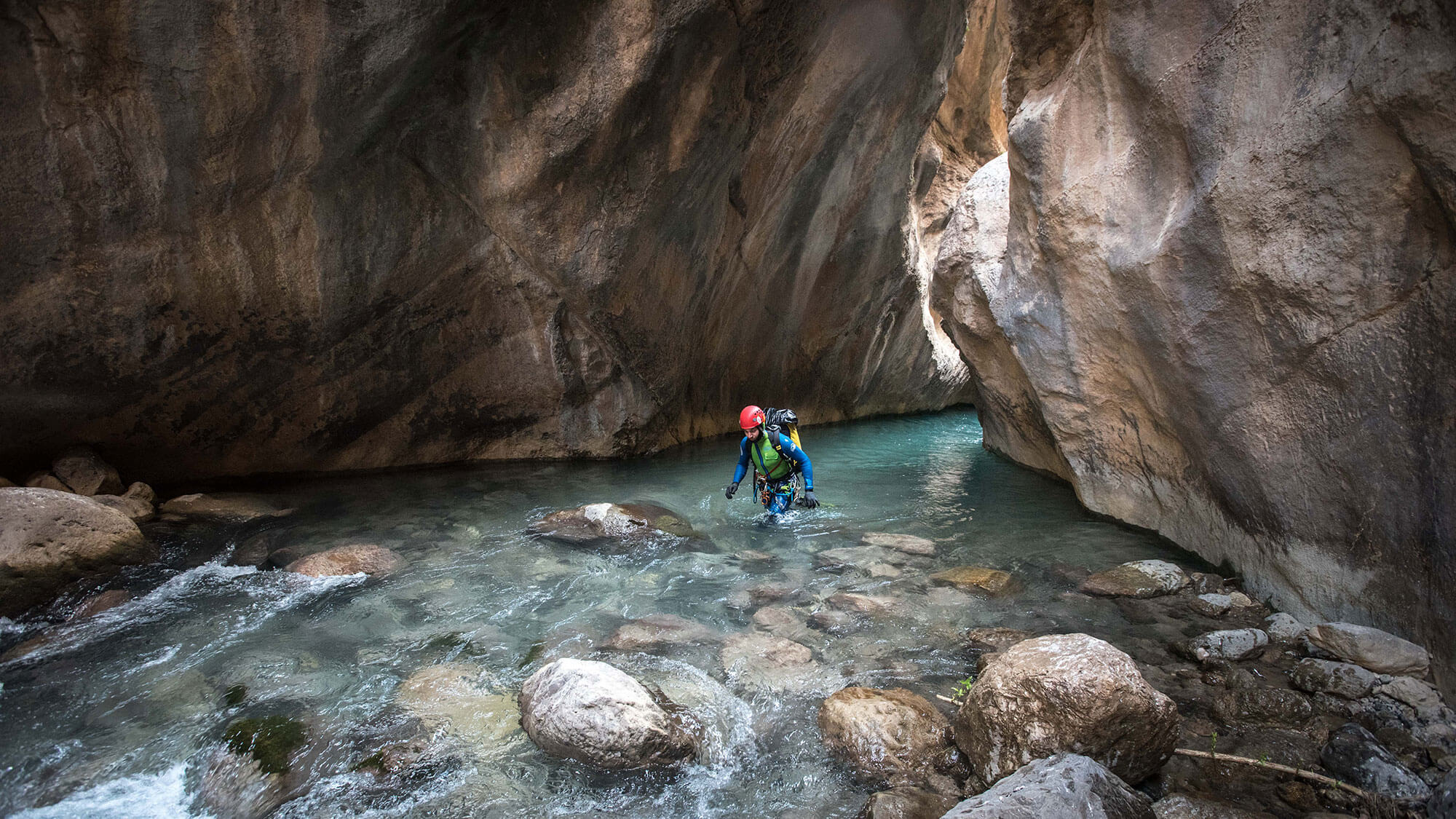 Iranian Canyoneer Mohammed Chavoshi exiting a limestone gorge at the Ziv Davand canyon