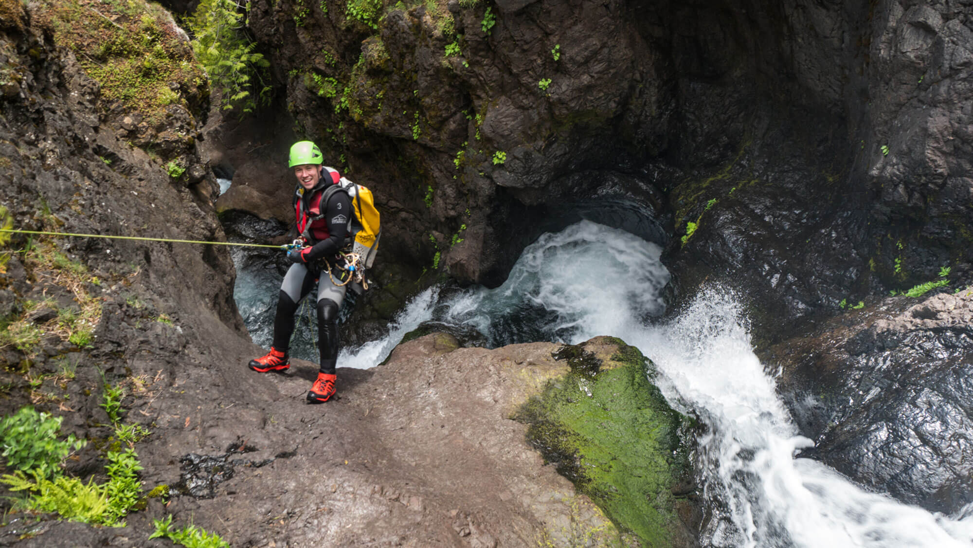Jake on the first descent of Quicksilver Canyon, I-90 corridor, Washington, 2019. One of those canyons hidden just off the beaten path, we almost expected to find anchors already in this canyon. If anyone had been here before, they left no trace. Photo by Kevin Steffa.