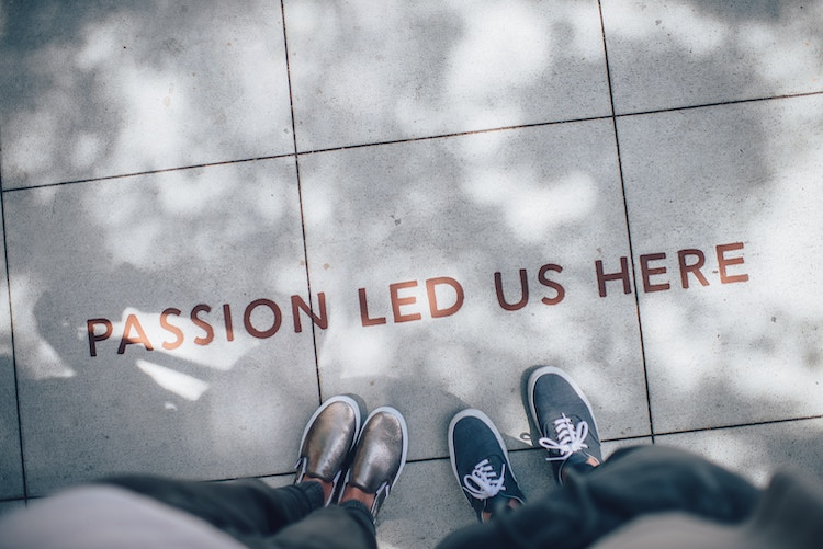 A lettering on the ground that reads 'Passion led us here'