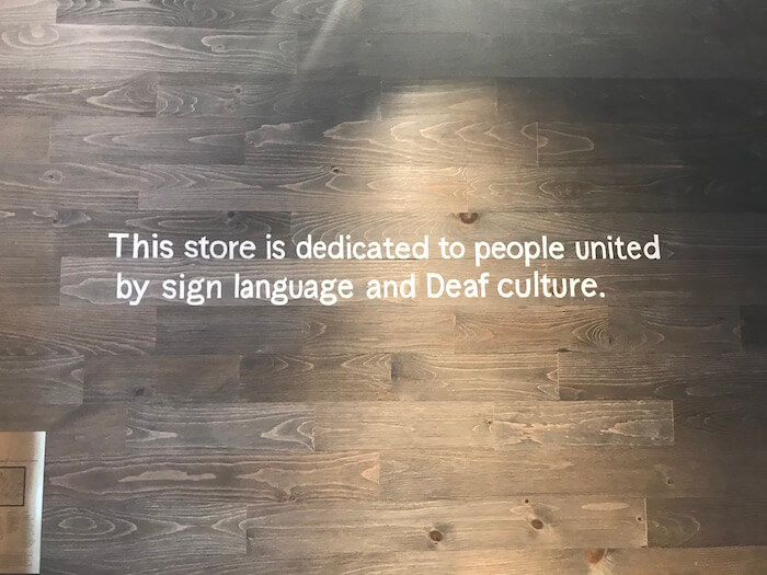 A quote at the signing Starbuck store that reads: This store is dedicated to people united by sign language and Deaf culture.