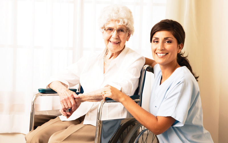 caregiver with elderly senior women home from the hospital