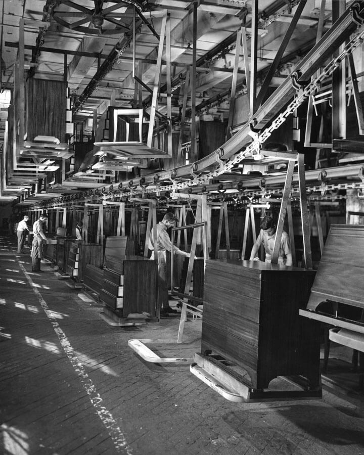 Black and white image of manufacturing assembly line in 1950's