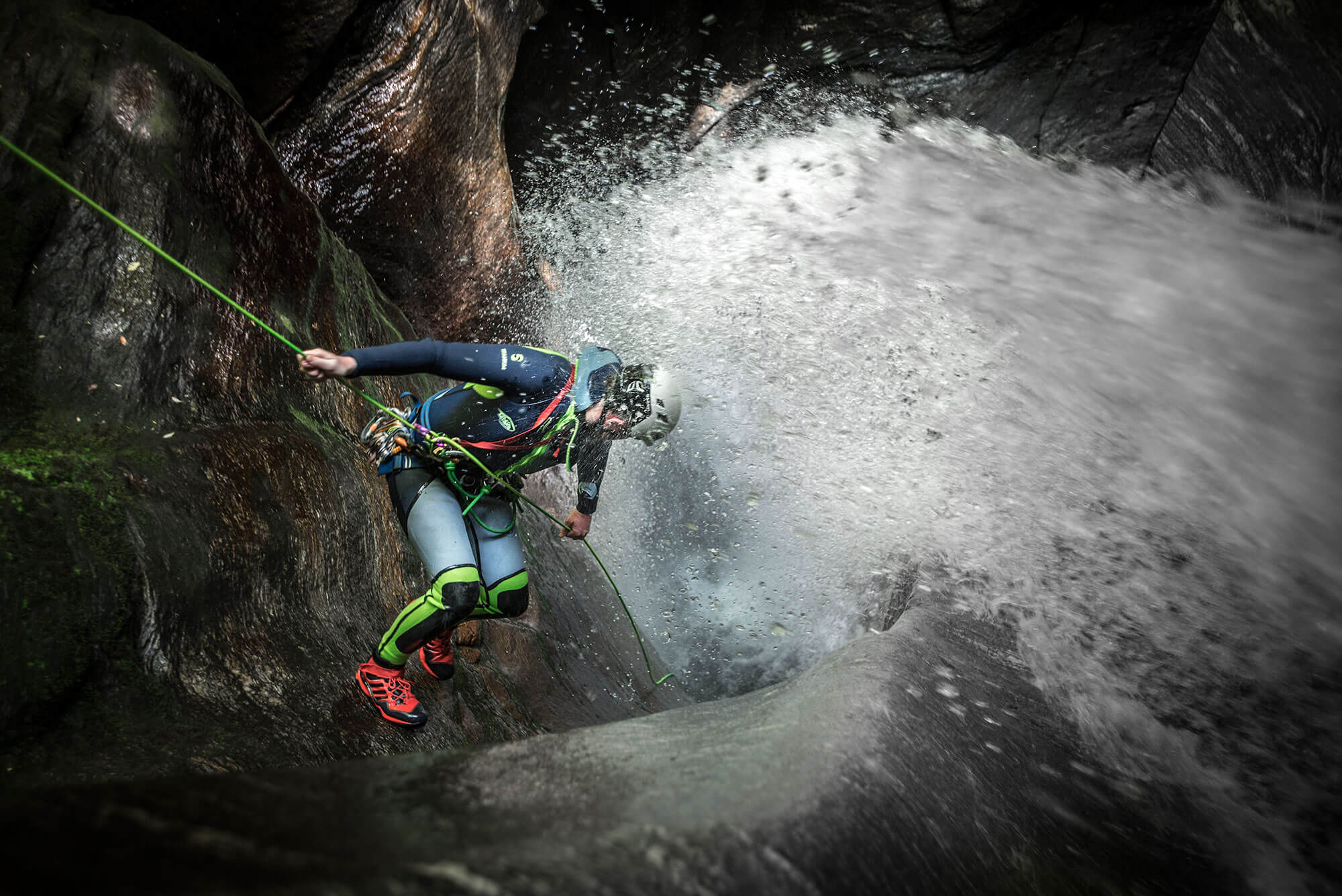 Rappelling in the canyon in New Zealand
