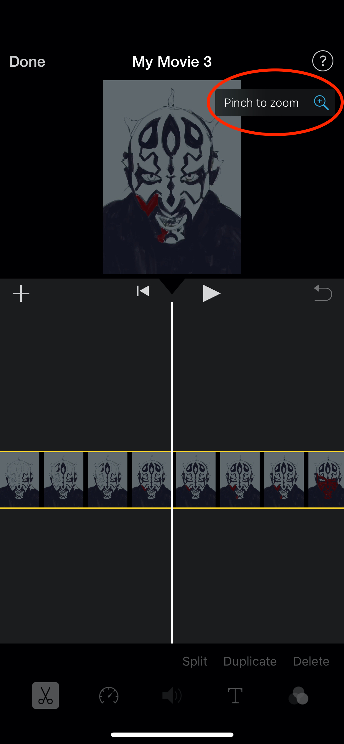 Screenshot of iMovie project showing magnifying glass button